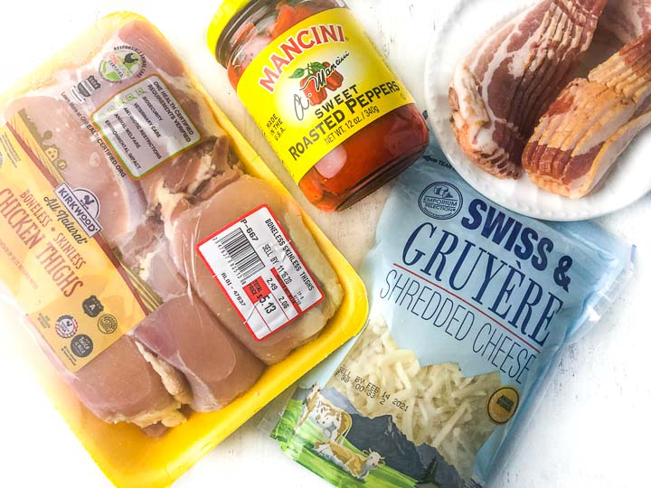 ingredients to make these wrapped chicken thighs: sweet roasted peppers, bacon, Swiss gruyere shredded cheese and boneless skinless chicken thighs