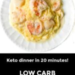 white plate and skillet with keto spaghetti squash alfredo with seafood and text overlay