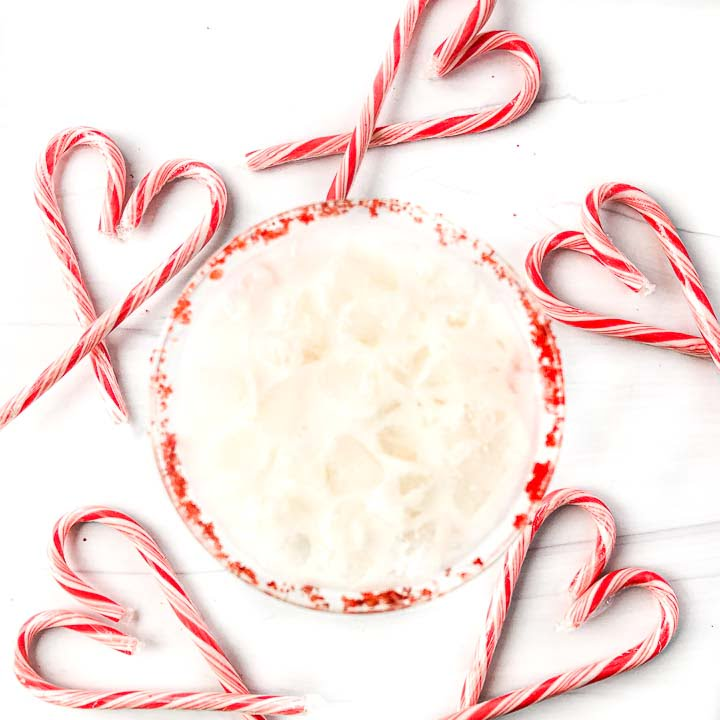 aerial view of candy canes in the shape of hearts with the peppermint drink in the middle