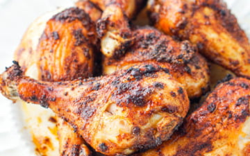 white plate with bbq air fryer chicken drumsticks