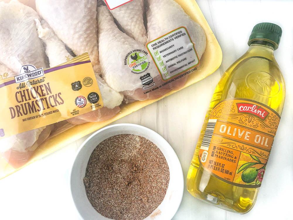 air fryer drumsticks ingredients: raw chicken legs, spice rub and olive oil