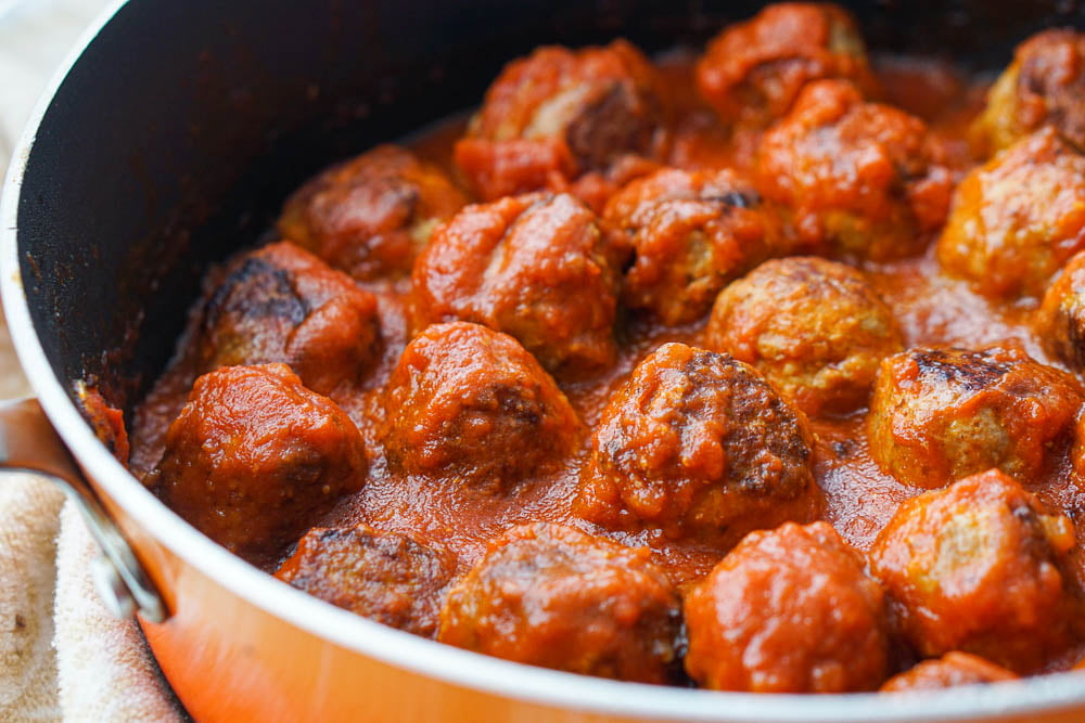closeup of pan with meatballs and sauce that are low carb