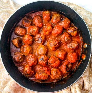 pan of keto turkey meatballs with tomato sauce