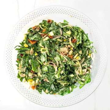 clear glass bowl with creamy keto spinach salad