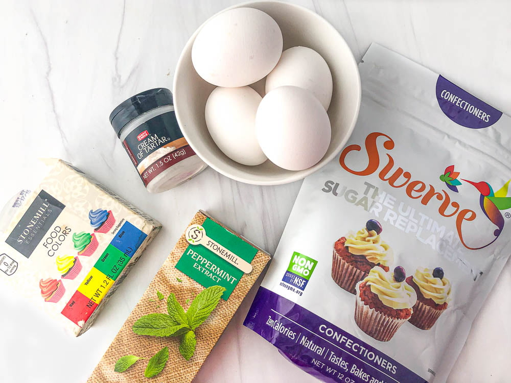 ingredients for sugar free meringue cookies: eggs, Swerve sweetener, cream of tartar, food coloring and peppermint extract