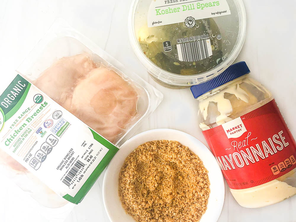 ingredients to make low carb fried chicken, chicken breast meat, pickles, mayonnaise and pork rind breading