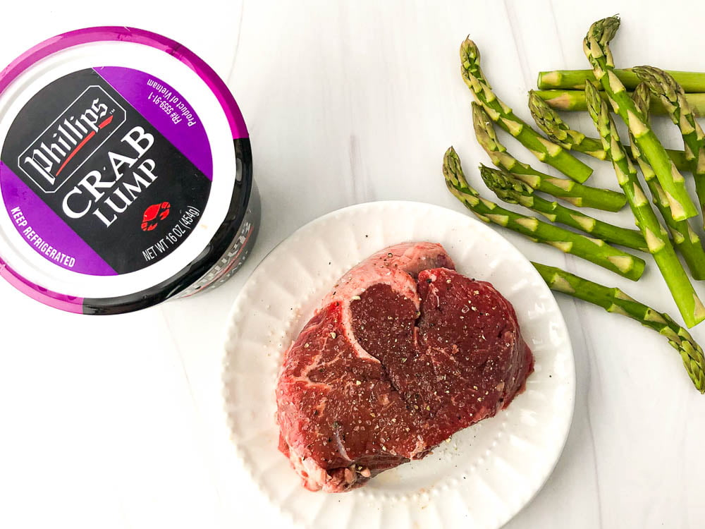 ingredients used in low carb steak Oscar - lump crab meat, a beef tenderloin steak and raw stalks of asparagus