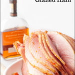 white platter with sliced apricot bourbon glazed ham and text overlay