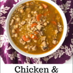white bowl with Instant Pot chicken barley soup and colorful purple tea towel and text overlay