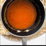 pan of keto buffalo sauce and text overlay