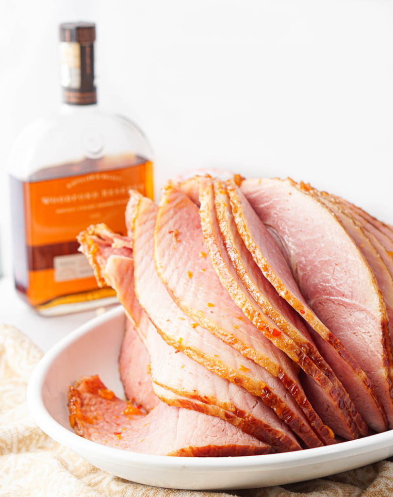 closeup of the finished sliced apricot bourbon glazed ham