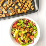 cookie sheet and salad bowl with keto croutons and text overlay