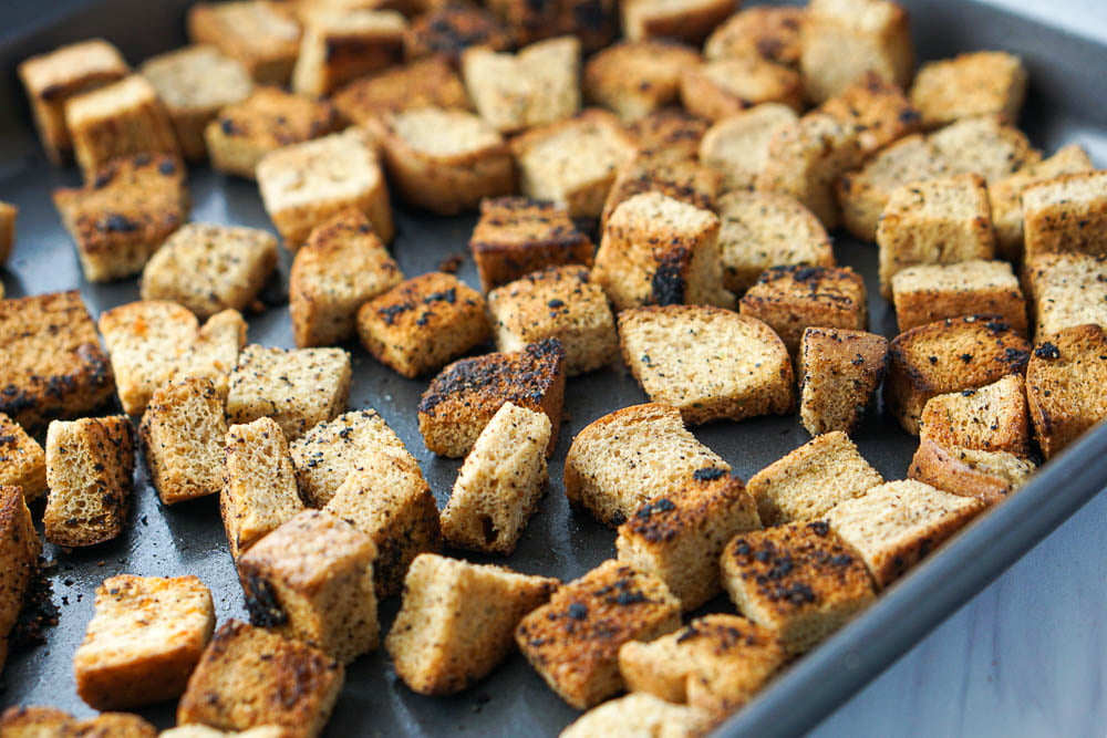 cookie sheet with a close up of the garlic and herb keto croutons