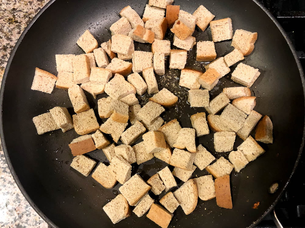 large skillet with bread cubes