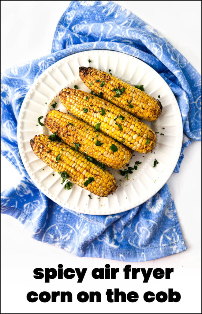 white plate with spicy air fryer corn and text overlay