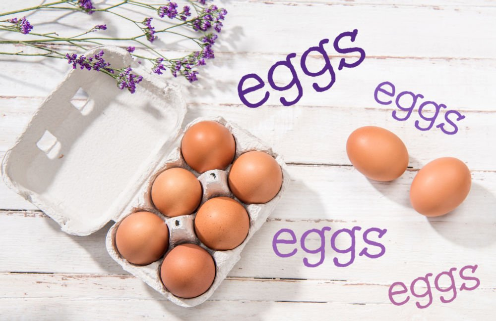 eggs in a carton with lavender sprigs and text