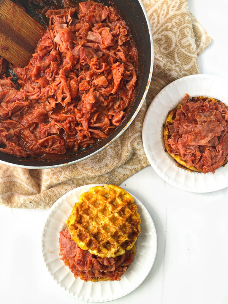 aerial view of a pan of sugar free ham barbecue and two plates with waffle bun sandwiches