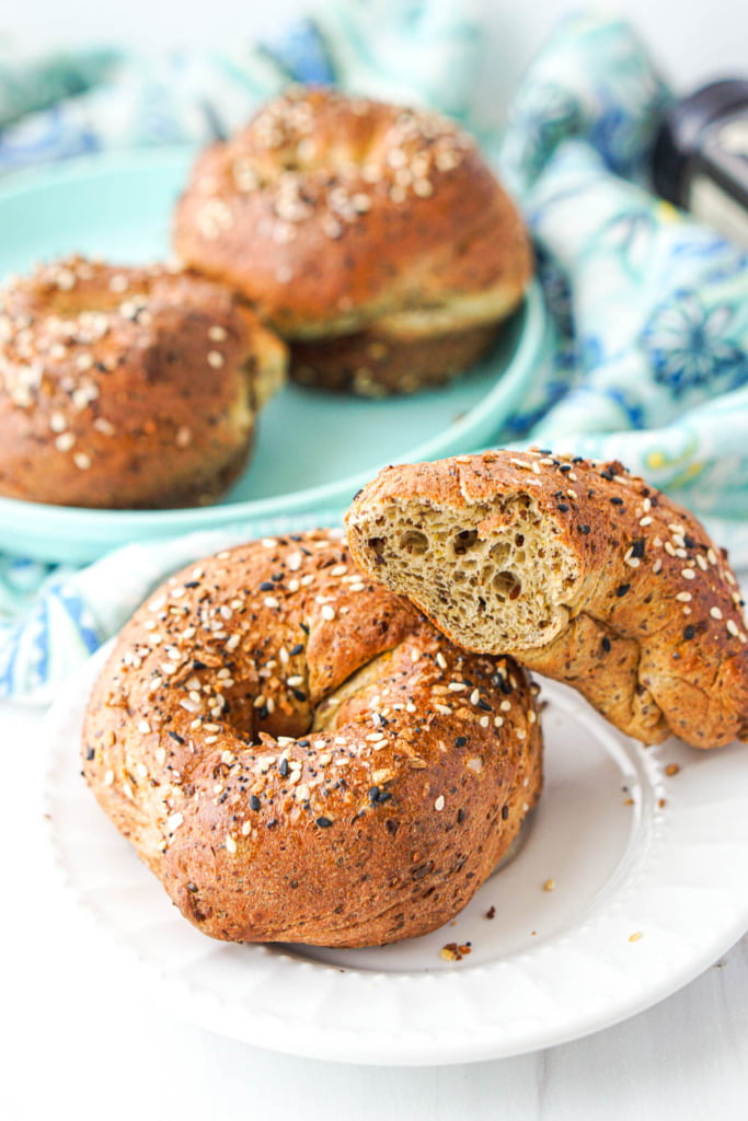 closeup fo an everything keto bagel and half of one to show airy, chewy texture