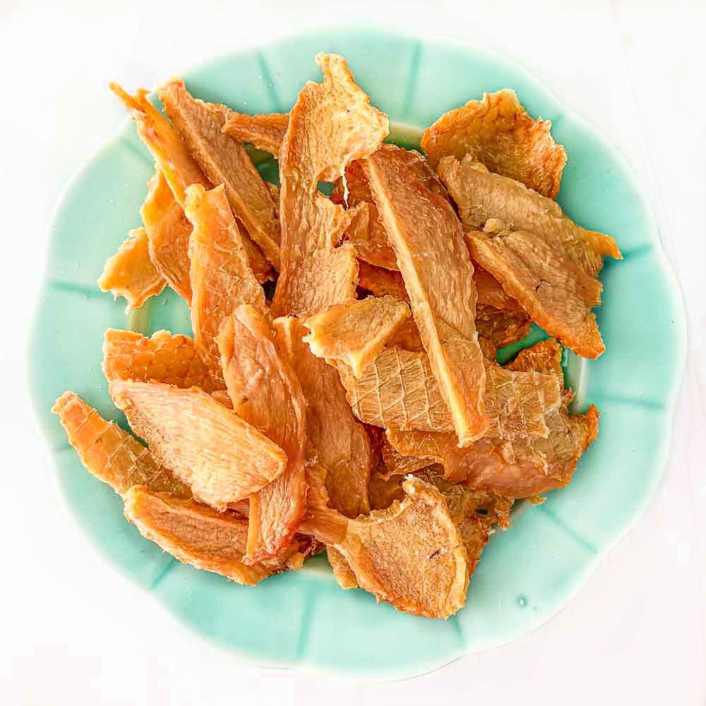aqua plate with chicken dog jerky