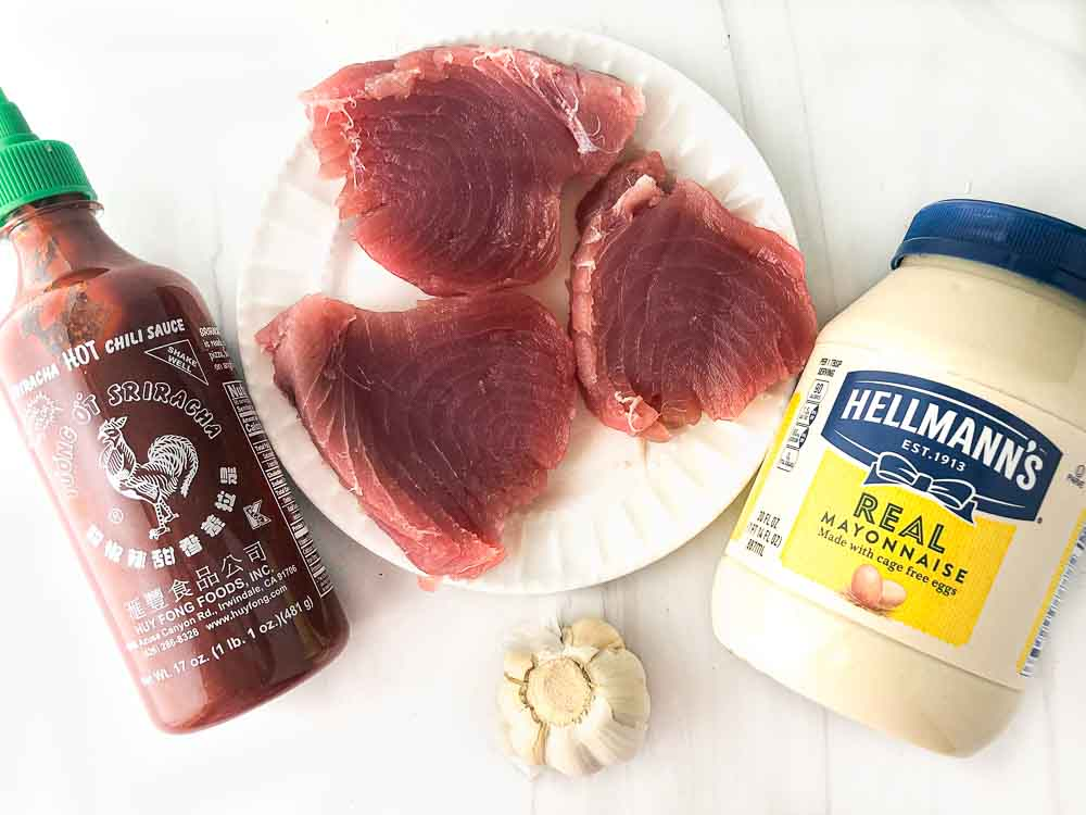 ingredients to make dish -  sriracha sauce, raw tuna steaks, mayonnaise, garlic cloves