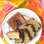 white plate with keto protein powder banana bread and colorful tea towel and text