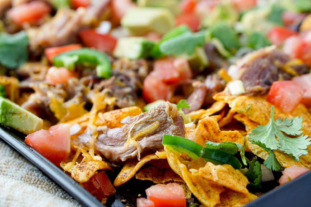 closeup of a tray of nachos with pulled pork