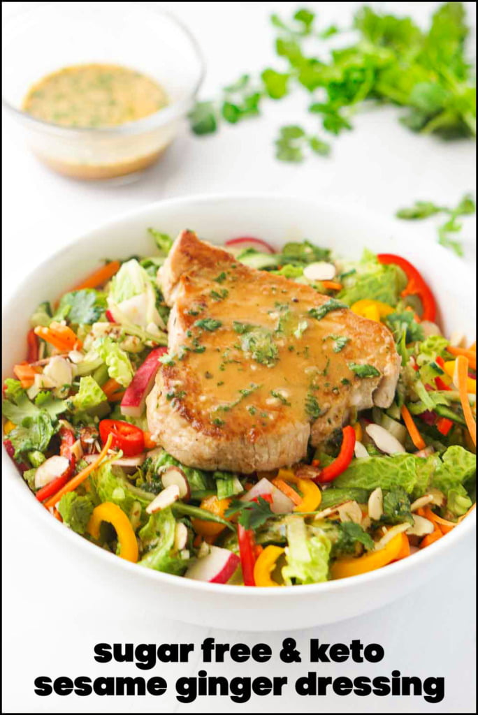 white bowl with tuna steak salad and sesame ginger dressing and text