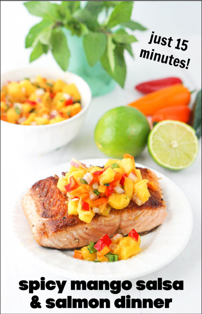 white plate with salmon topped with mango salsa and text