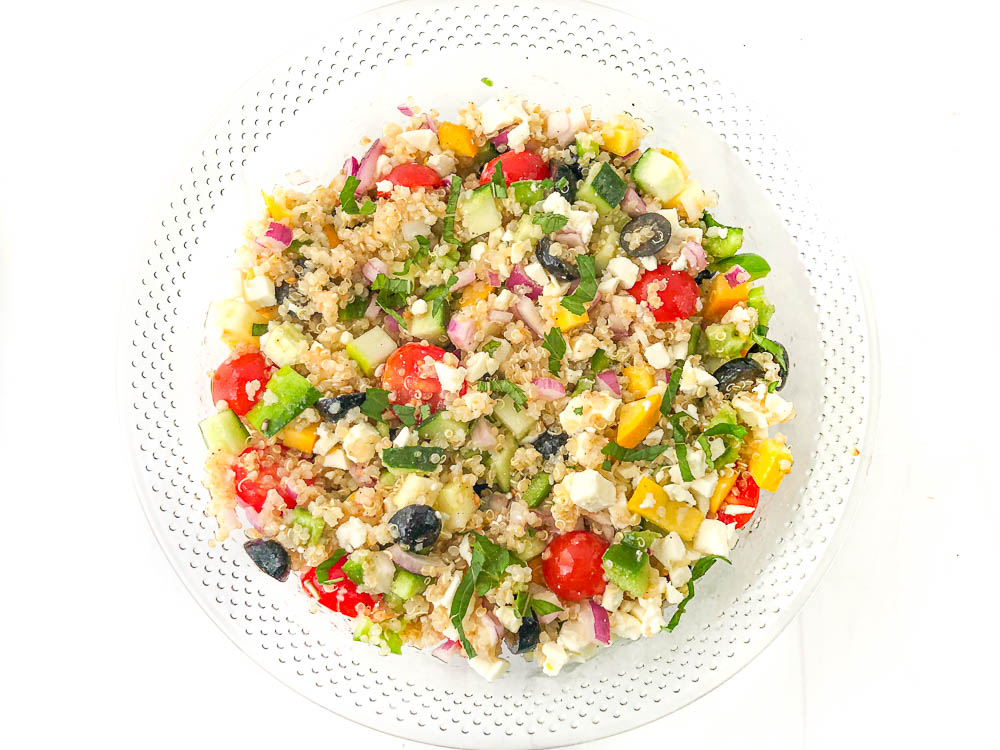 glass bowl with Greek chopped vegetable salad