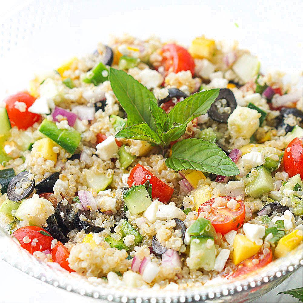 close up of a bowl of zucchini mint quinoa salad