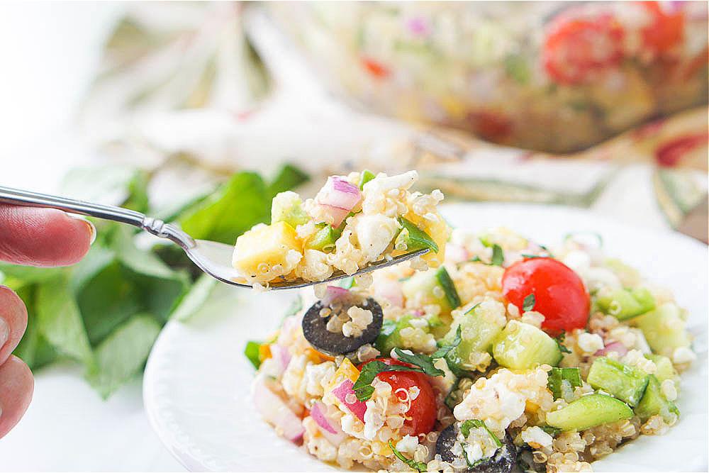 a forkful of Mediterranean quinoa salad
