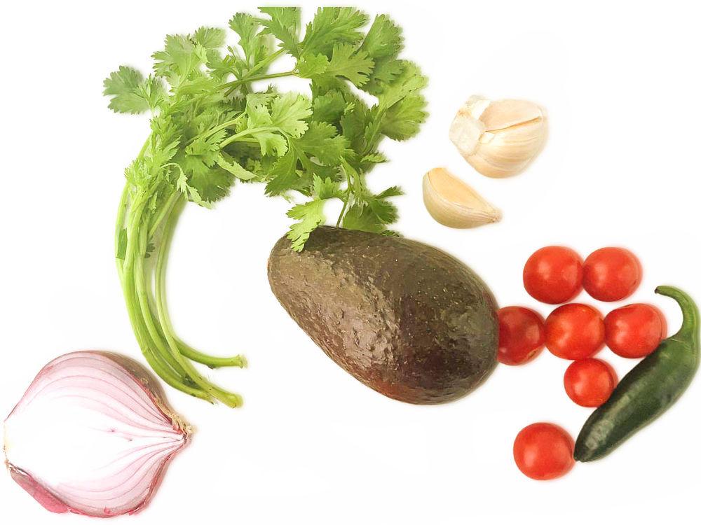 ingredients to make recipe - red onion, cherry tomatoes, avocado, jalapeno, garlic and cilantro