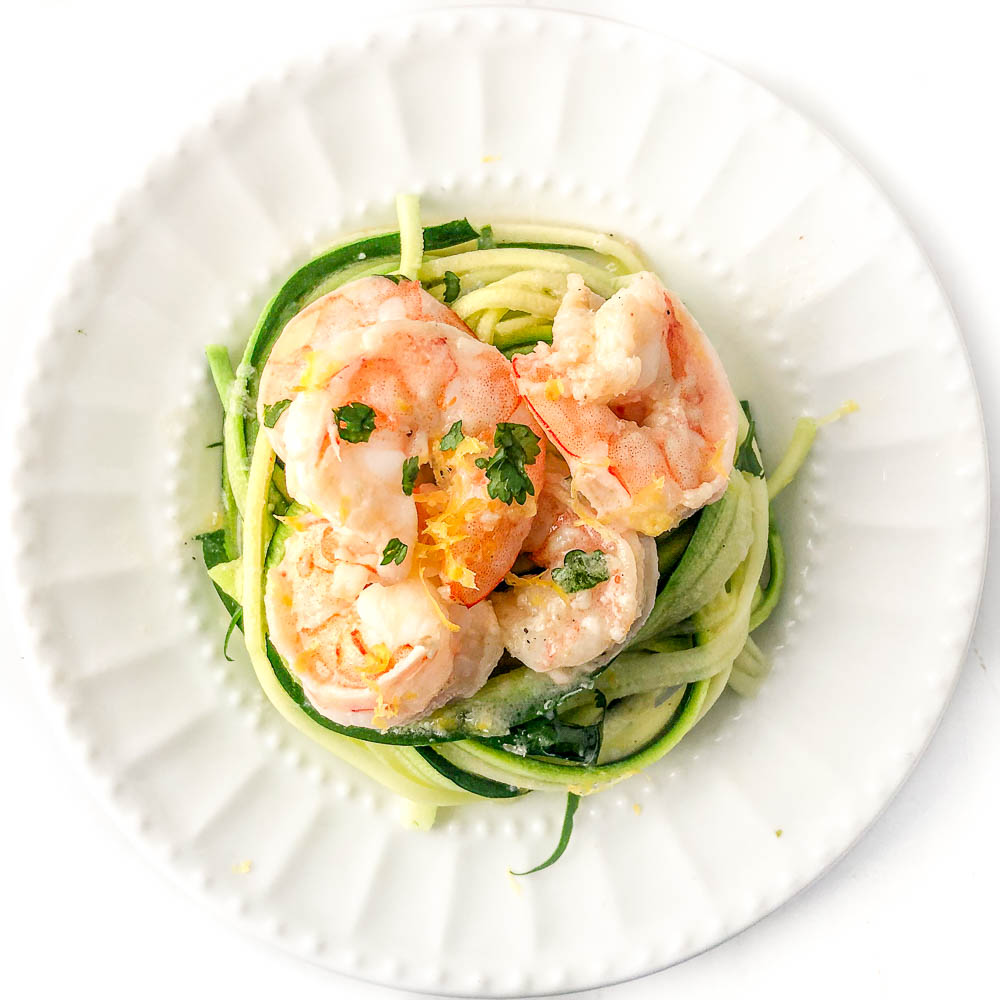 white plate with zoodles and keto shrimp scampi