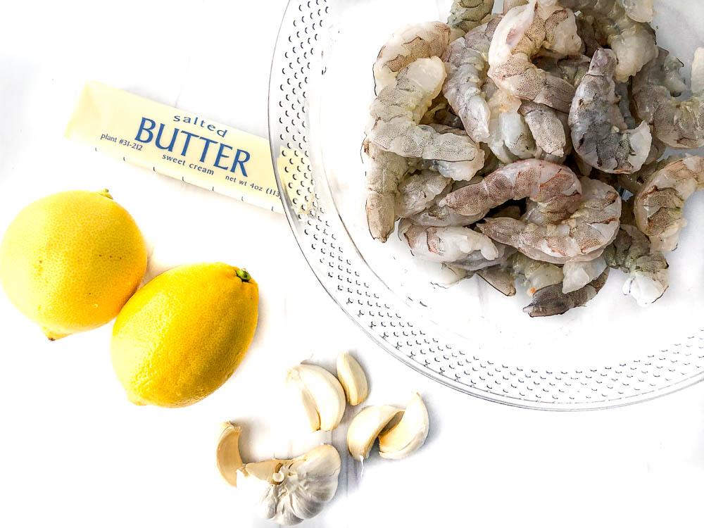 recipe ingredients - butter, lemons, garlic and shrimp