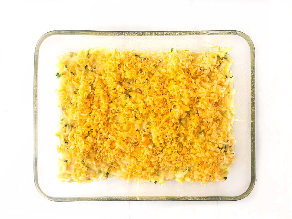 baking dish with cheesy casserole ready to be baked