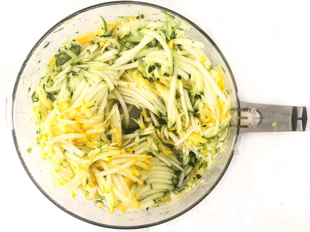 food processor bowl with shredded squash