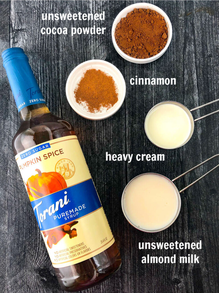 ingredients to make this hot drink - Torani sugar free syrup, cinnamon, cocoa powder, heavy cream and almond milk