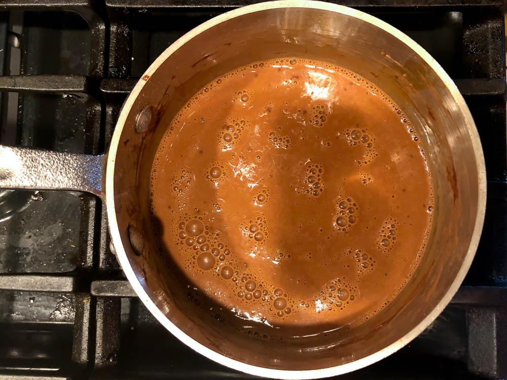 saucepan on the stove with chocolate mixture