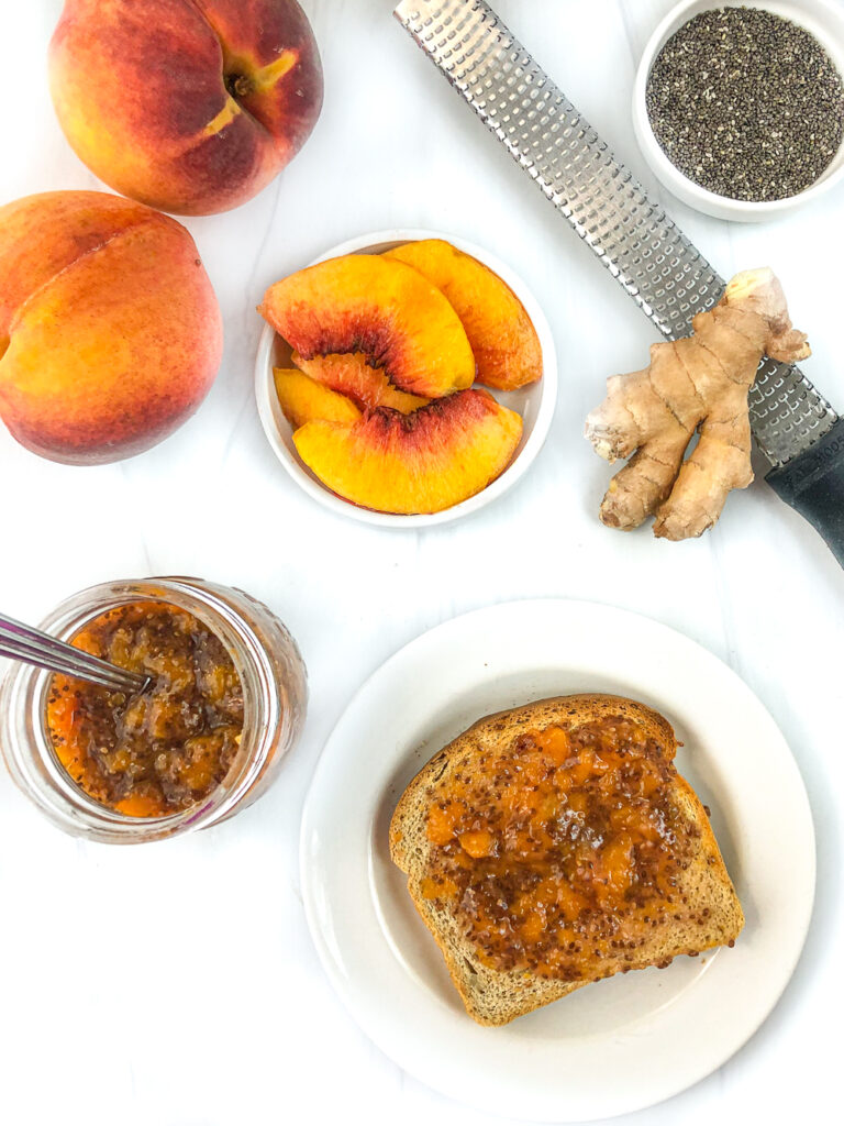 plate with a piece of toast with peach chia seed jam with fresh peach and ginger root and chia seeds and a microplane