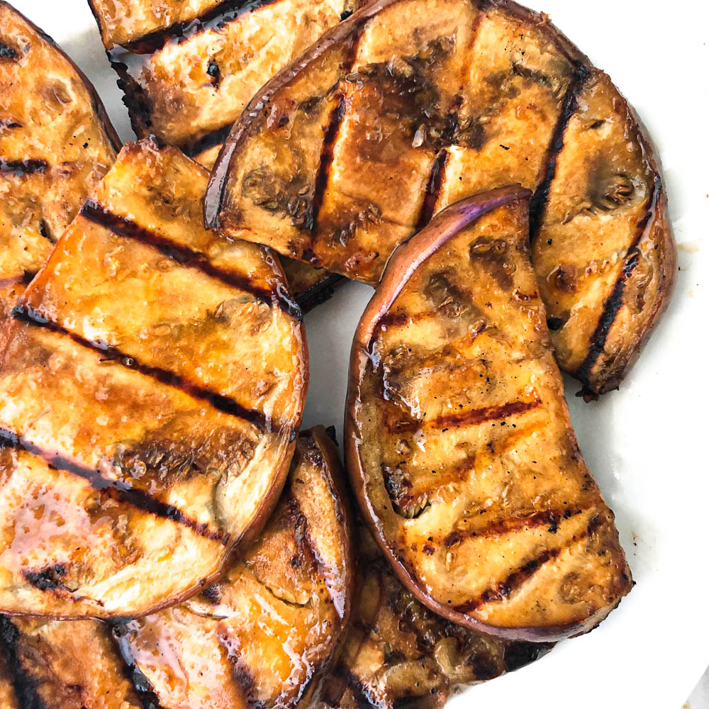 closeup of grilled slices of marinated eggplant