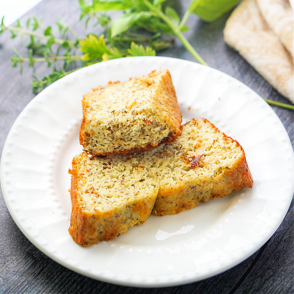 white plate with sun dried tomato protein bread slices