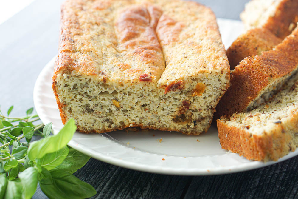 sliced loaf of low carb quick bread with slices