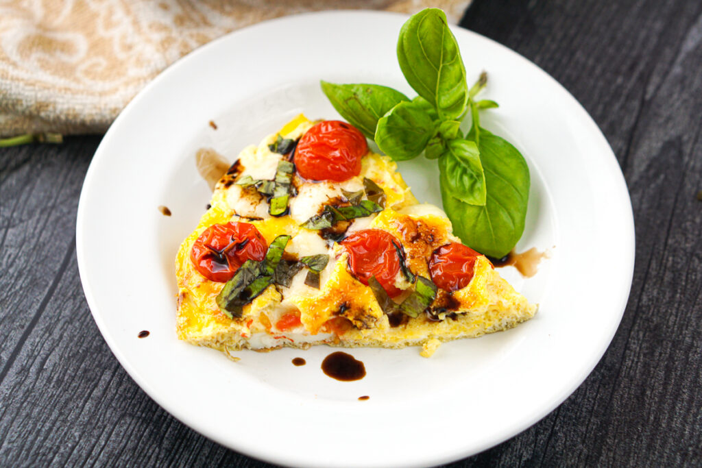 a slice of egg recipe with balsamic reduction drizzled over