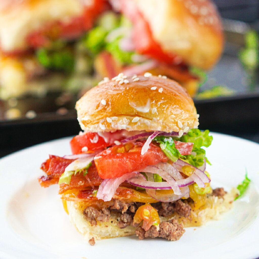 closeup of a bacon cheeseburger slider