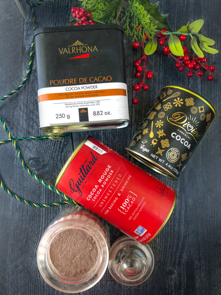 Divine, Guittard and Valrhar cocoa powders and a jar of cocoa mix