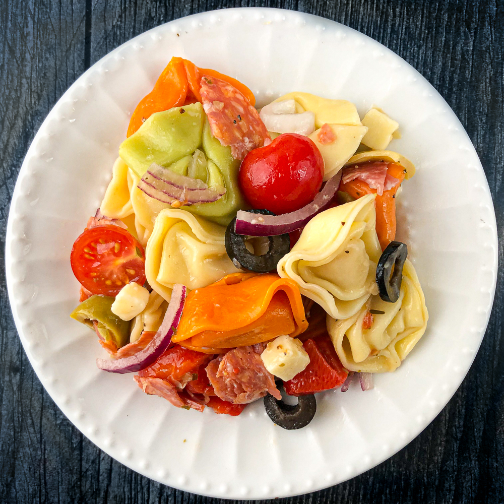 white plate with antipasto tortellini salad