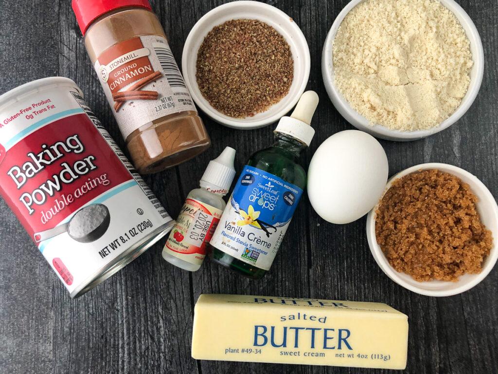 ingredients to make apple keto muffin - almond flour, stevia, butter, egg, cinnamon, baking power, brown sugar sweetener